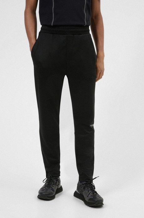Tracksuit bottoms in performance-stretch twill with structured inserts, Black