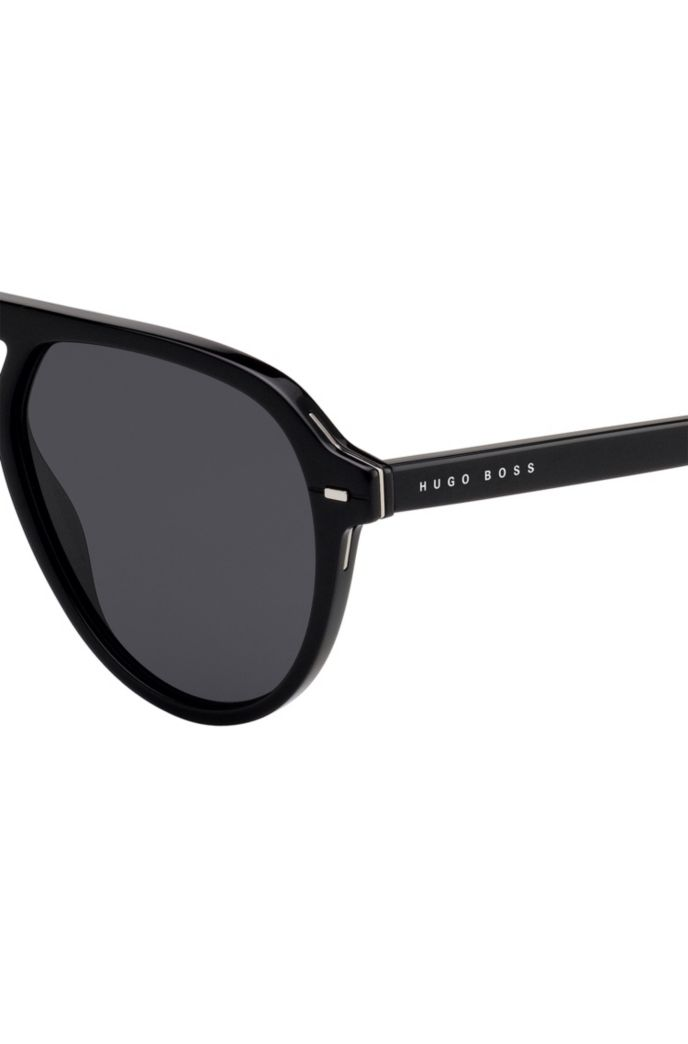 Sunglasses in black acetate with hardware inserts