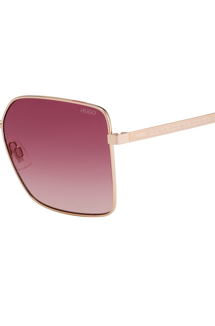 Rose-gold metal sunglasses with cropped-logo temples