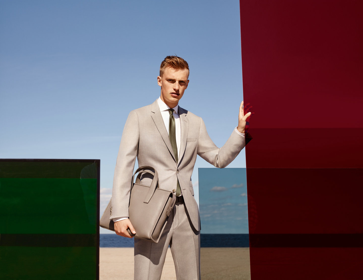 Men model, wearing beige suit